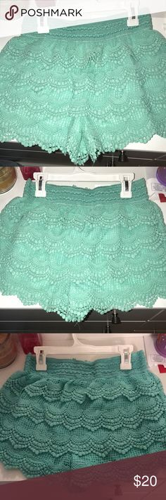 Lace Shorts NEVER WORN lace fabric stretchy shorts. Turquoise. Charlotte Russe. Size M. Charlotte Russe Shorts