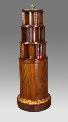A fine 19th Century figured Mahogany Revolving Bookcase.