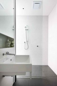 scandinavian bathroom designs white wall tiles, grey floor tiles, frameless glass, tapware