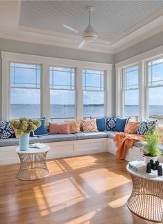 seaside living room with wide windows and built-in window seats
