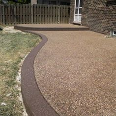 Exposed Aggregate surface with stained accent border.  Replaced existing wood deck in Clinton Twp., MI | Yelp