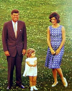 President and Mrs. Kennedy with daughter, Caroline.