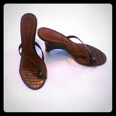 """LAUREN Ralph Lauren Leather Wedge Sandal These are a show stopper with comfort.  These sandals are the final touch to your favorite dress, summer shorts or casual skinny jeans. Any way you look at it, you can't go wrong with these classy sandal wedges. Made in Brazil. Leather alligator pattern on upper and wooden wedge heel. Size 9 1/2 Approximately 4"""" wedge heel. These shoes are in MINT CONDITION! Ralph Lauren Shoes Sandals"""