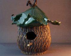 casa de passarinho de cerâmica