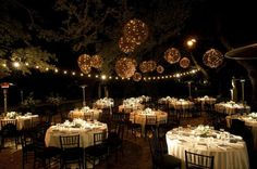 Just about died when I saw this picture!! I absolutely LOVE the hanging twig balls with lights!! Now I know I said I wasn't a fan of the flower balls, but these are beautiful! Can we incorporate these at all? Can I be a bride that pulls of lighted twig balls? =)