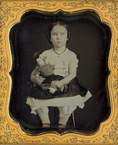1/6 plate daguerreotype of young girl and her doll.