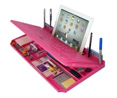 Pink Keyboard 6 in 1 Desktop Organizer This fabulous pink keyboard is more than meets the eye. It's also a sleek desk organizer, phone stand and much more. Available in USB or Bluetooth Wireless. Pink Keyboard Desktop Organizer Retail $39.95 Only $29.95. I gotta get this!!!