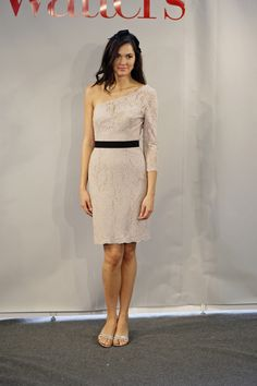 Nude colored lace, accented with a solid belt and matching hairpc from color palette.