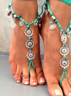 barefoot sandal with light blue long cord that ties high on leg tibetian Silver flowers, Silver charms and ceramic beads.  This listing is for one