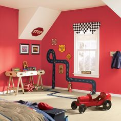 Primary colors are terrific for kids' rooms. Here, a true red is just the right choice for a budding gearhead's bedroom. Sherwin-Williams Stop SW6869