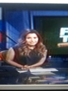 Molly Qerim in Black Shirt and White Pants