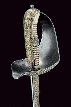 Sable de presentacion. Siglo XIX. España. Hoja grabada y sobredorada.  Long.: 93 cm