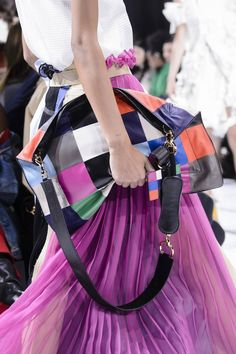 """Patchwork, rainbows, tutti-frutti – this is the season to wear your world-loving sentiments across your chest. You will find a whole spectrum of colours in store but one of the firm favourites is [link url=""""http://www.vogue.co.uk/brand/sacai""""]Sacai[/link]'s patchwork leather """"pillow bag"""". Pop a little [link url=""""http://www.vogue.co.uk/brand/uniqlo""""]Uniqlo[/link] puffa in there, and it would be great for a snooze too."""