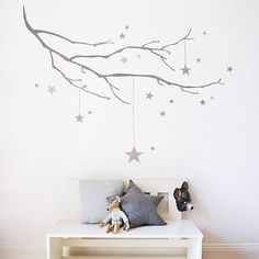 Our Winter Branch with Stars wall sticker looks great in a nature inspired nursery or child's bedroom. View at www.kokokids.com #nurserywalldecals #naturenursery #kidswallstickers