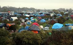 Migrants are pictured in the New Jungle migrant camp in Calais, where around 6.000 migrants live in the hope of crossing the Channel to Britain,