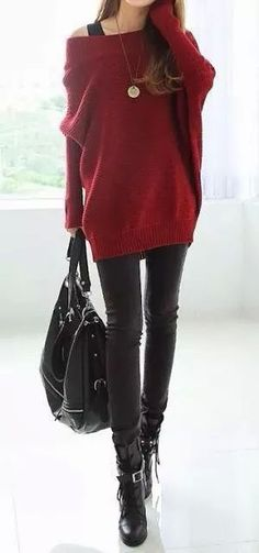 Red sweater and black skinny trousers.