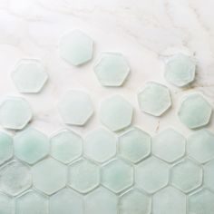 We love the barely there quality of our translucent Glass hue, Dew Drop.  What do you think? #handmade #recycled #glasstile #hexagon