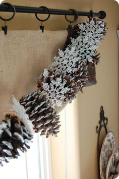 Pine cone and snowflake garland. - Note: I would add greenery sparcly sprinkled with snow spray (lightly)