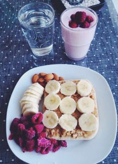 Banana and PB on toast with berries, banana and almonds. Plus a super berry smoothie!!!!