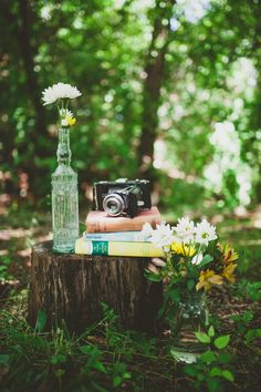 Vintage camera and stack of books | Photography: Catie Bartlett Photography  - www.catiebartlett.com  Read More: http://www.stylemepretty.com/2014/05/27/earthy-summer-backyard-wedding/