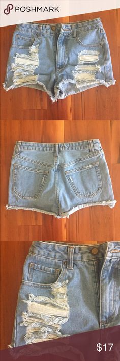 Mid rise light denim shorts Mid rise distress light denim shorts in size 25 from forever 21. Never been worn so they're practically brand new! Forever 21 Shorts Jean Shorts