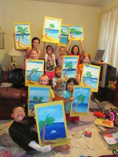 My students proudly showing off their paintings at the summer art camp. Art teacher: Susan Joe
