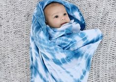 A best seller! Hand-dyed, 70% bamboo, 30% cotton swaddle blanket. Hand dyed using traditional Japanese Shibori techniques with natural indigo dye....
