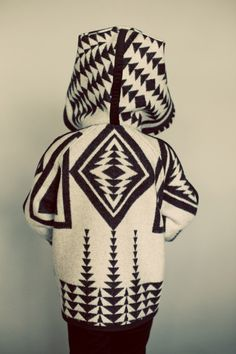 """Native American for """"my daughter""""    This swing coat will make your heart skip a beat.  Finally, a jacket that is easy to put together and less time consuming.  You can choose from two options, a fully reversible coat with bound edges all around, or a fully lined one for the woolen fabrics."""
