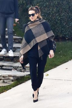 Blanket coat, poncho, oversize scarf—whatever you want to call it, you need one this season. For inspiration, see how Kate Beckinsale styles it.