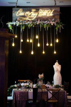Hanging Edison lights and romantic wedding details