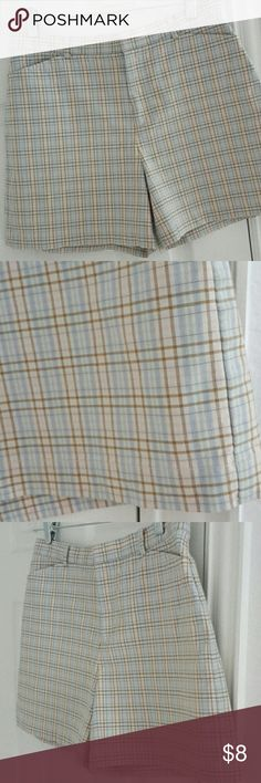 """Pastel Dockers plaid shorts Preppy & classic shorts - pastel blue, pink, green, tan & white -  clean lines, pockets in front, darts for shaping in back. Dockers size 10 Petite fits me snugly as a size 6, not sure they'll fit a 10: 15"""" outseam, 30"""" waistband w/no stretch to it but shorts themselves have a little stretch as 97% cotton/3% Lycra. Small pinpoint spot on front of right leg shown in pic. Dockers Shorts"""