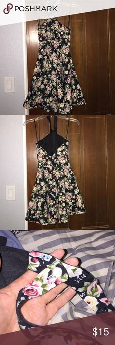 Floral Halter Dress This dress is summery and cute! It was only worn one time and is in great condition. Also has 2 pockets! 100% cotton :) Dresses
