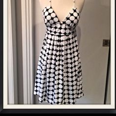 Black and white polka dot dress Super cute black and white strappy polka dot dress.  Sexy deep V-neck line.  95% polyester  5% spandex.  NWOT.  Ties in back to adjust amount of support needed.  Lightly padded. J . F . W. By Just For Wraps Dresses