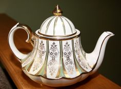A Geniune Royal Richmond English Teapot Antique Made in England Numbered Fantastic, via Etsy.