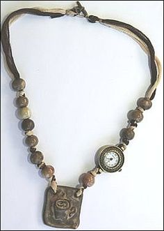 Coffee Time Necklace - Beading Daily by Jessica Stoops. Handmade Ceramic Beads by Gaea. Fairy Silks purchased from Marsha Neal Studio. Help support handmade jewelry artists and bead artists by voting for this for Bead Star 2012. Voting closes on May 28, 2012. Thanks!
