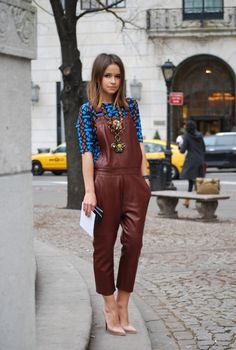 Swag! Mira Duma in maroon leather overalls!