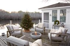 setting up christmas at the boathouse.from Life/Style by Tricia Foley Lake Cottage, Cottage Living, Outdoor Spaces, Outdoor Living, Outdoor Decor, Outdoor Seating, Theoule Sur Mer, H Design, Beach Cottages