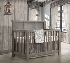 RUSTICO - Convertible crib to double bed.  Sold with or without pholstered panel.  A classic barn style inspired from Tuscany with pronounced mortise and tenon joinery.   Available in 4 colors: Sugar Cane, Owl, Mink & White.  Made of solid oak wood with a unique ''décapé'' rustic finish.  Shown here in Owl color.  Made in Canada.  Greenguard certified to offer you peace of mind.  Safe, secure and sturdy design to grow along with your child, throughout their life experiences.