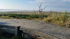 vanuit een bunker het Groene Strand in Terschelling overzien