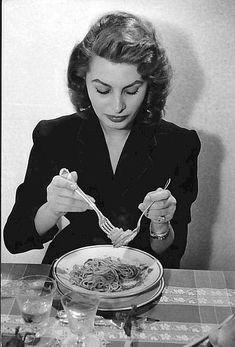 Photo of Sophia Loren eating spaghetti.- Minneapolis Star-Tribune-photo by David Seymour of Magnum Studios, New York - December 4, 1955