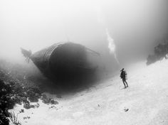 A diver gazes at the Hilma Hooker, a cargo ship purposely sunk off the Caribbean island of Bonaire. The site is a popular destination for scuba divers.