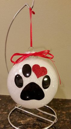 These beautiful personalized glittered pet ornaments are 3.5 flat disc shape and will be loved by all. Each ornament is hand glittered in your choice of colors. Please indicate your color choice in the notes to seller section along with the name of your pet.  Blue, Red, Pink, Purple, White, Yellow, Green, Black, Silver, Gold  Featured in My Fresh Finds Treasury.  https://www.etsy.com/treasury/MTk2MTk3Njd8MjcyODEzNjA2Ng/my-fresh-finds?index=9&ref=treasury_search&atr_uid=