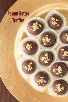 Chocolate Peanut Butter Truffles - Creamy peanut butter filling is coated in a rich chocolate shell to create an impressive and delicious truffle! You won't be able to eat just one!