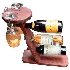 Holds 2 long stem glasses and a wine bottle opener. Made of western red cedar. No assembly required. With the Gronomics Table Top Wine Rack, your favorite indulgence will be Awesome Woodworking Ideas, Woodworking Joints, Woodworking Techniques, Woodworking Furniture, Fine Woodworking, Woodworking Projects, Woodworking Videos, Sauder Woodworking, Woodworking Quotes