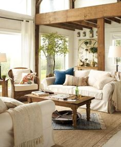 THIS ONE IS ALSO NEUTRAL COLOR PALETTE BUT WE LIKED- PERHAPS THE PILLOWS AND CLOCK AND BIG GREEN TREE ARE WHAT MAKE IT WORK FOR US; LIKE ADDITION OF BOWL UNDER COFFEE TABLE; LOOKS COMFY, LIVED IN, HAS PERSONALITY; THREE DIFFERENT PILLOWS...SO WISH WE COULD HAVE THE WOOD/BEAMS BUT NOT YET...