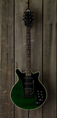 An emerald green finish Guild Red Special.  The Kahler tremolo, and plain black pick guard indicate this is most likely from the 1983-1985 run, but there are so many custom features on this one it's possible it's from the later run, but not likely, especially in light of how it appears in the host site (thegearpage) as among others from the original 80s run.