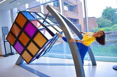 Make sure to visit this giant Rubik's Cube on the University of Michigan's North Campus the next time you're in town! Rubik's Cube, Michigan Travel, University Of Michigan, Ann Arbor, Something To Do, Innovation, Typography, Community, Fan
