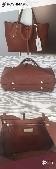 Annabel Ignall leather tote Called Mahogany on AI website but is more of a luggage brown color. New with tags. Perfect condition. One large interior zippered pocket. Handle drop 9 inches. 19 L x 12 H x 4.5 D Annabel Ignall Bags Totes