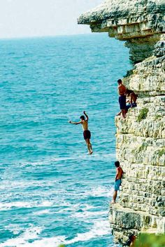 Jump from a cliff into deep water.