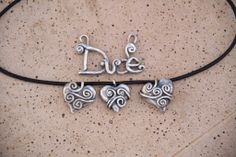 Designs By Chelle Lost Wax Casting Silver Heart Pendants.